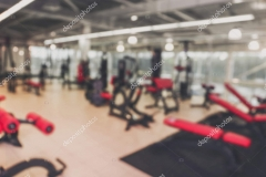 Blurred view of weight lifting machines in gym